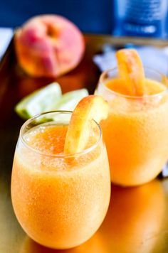 The Perfect Peach Daiquiris With Labor Day coming up, you can never have too many cocktail recipes in your arsenal. These The Perfect Peach Daiquiris will be the hit of your party! Peach Rum, Peach Daiquiri, Peach Drinks, Fun Drinks, Yummy Drinks, Peach Alcohol Drinks, Daiquiri Cocktail, Peach Margarita, Mixed Drinks