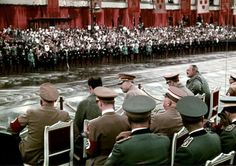 Beautifully colorized photo of Hitler viewing a parade with NSDAP officials