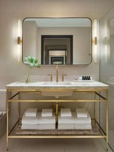 Summer style!! White and brass and marble sink vanity bathroom!! Modern and elegant style!! LOVE the sleek modern sconces!!