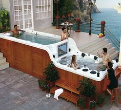 Double decker hot tub with bar and tv.... Holy crap by may