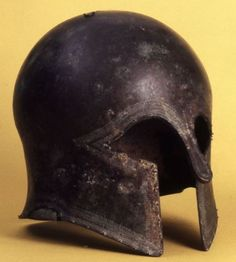 "DODONA: Bronze Corinthian helmet with the inscription ""ΟΛΥΜΠ"", 650-570 BC. Excavated at the Sanctuary of Zeus, Dodona and now in the British Museum, London."