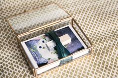 Wow your wedding and portrait clients with a beautiful and modern glass photo box! Hand made of glass and a matte gold or silver antiqued brass.
