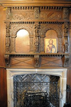 """Before the sixteenth century fireplaces in individual rooms were not common.  Buildings were typically heated by central, open fireplaces in a main room, vented through holes in the ceiling.   The individual fireplace was therefore a great modern convenience to be celebrated. The Elizabethan Room fireplace has a stone lintel with a """"four centered"""" arch (a shallow arch that rises to a point in the center), typical of the earlier Tudor period."""