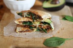 Vegetarian avocado quesadilla with caramelized onions and spinach. This quesadilla is full of flavor and perfect for weeknight dinners.