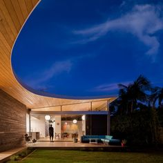 Aa House by Surfside Projects. Interesting Curved roof line, floor to celiing sliding glass doors, Tongue and groove wood ceilings