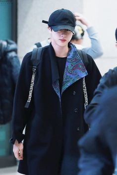 Jin wearing the coat Taehyung got him for his birthday.