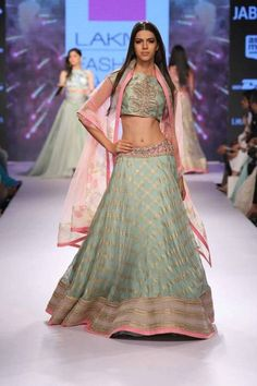 Anushree Reddy hit the runway hard with her 2015  Summer/Resort collection. Filling her collection with lenghas in soft colors like baby pink, light yellow, beige and moss, the outfits were a treat to the eyes of any Indian bride-to-be. All of her cholis were incredibly detailed with beading and embroidery and vibrant prints.