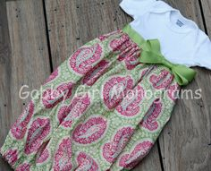 Onesie Daygown Dress Infant Baby by GabbyGirlMonograms on Etsy. Such a cute idea. She also sells a matching bib.