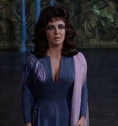 Cleopatra is wearing a lovely dress whilst she is talking with Marcus A. and begging for forgiveness http://mariaefmilliner.com/cleopatra-a-review-of-the-35-dresses-she-wears-on-the-movie/