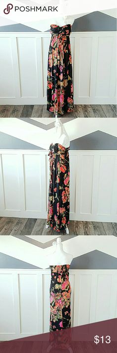 Hawaiian Floral Tube Top Maxi Dress Floor length tube top maxi dress. Dress ties in the front to cinch the chest area. There is stretchy matrial in the back from the shoulder blades to the bottom of the back for a flexible fit. The body and lining is 100% polyester. Dress has been gently used. Looks brand new. Machine wash cold, tumble dry low. Xhilaration Dresses Maxi