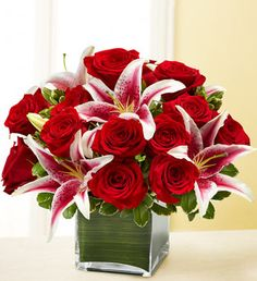 Modern Embrace™ Red Rose and Lily Cube-Hand-crafted arrangement of romantic roses and lilies, accented by variegated pittosporum $59.99- $79.99 $redroses #lilies #roses