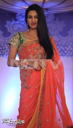 Rarely seen Deepti Bhatnagar was elegant in an orange sari teamed with a green blouse.
