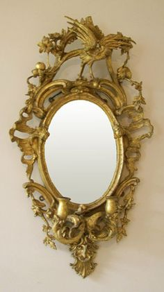 Antique mirror with candle cups.