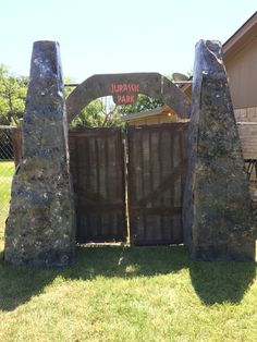 "I made this entrance for my boyfriends birthday party. I used cardboard boxes and butcher paper for the towers, and cardboard for the doors and sign. Lots of painting was involved but it worked out. I downloaded a Jurassic Park font to create the ""Jurassic Park"" sign."