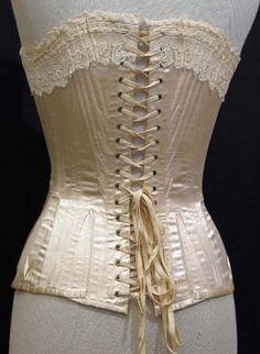 Antique Victorian Corset from 1890. Cream white satin fabric.