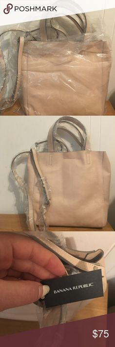 Banana republic unused dusty pink handbag Brand new dusty pink/ blush pink bag that can be used as a cross body or a handle bag. Comes with a matching zip pouch and all is still in original packaging and unused. The material is a super soft leather and is an unlined bag. Banana Republic Bags Satchels