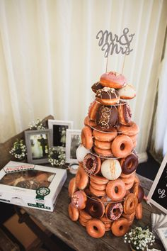 Love this wedding topper and donut tower