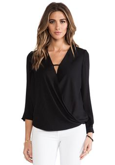 krisa Cross Surplice Blouse в цвете Черный | REVOLVE