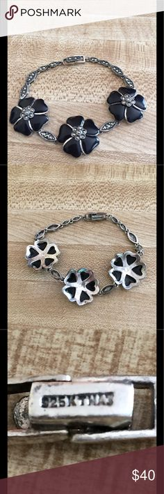 Vintage 925 silver & onyx  flowers bracelet The bracelet also has tiny cubic zirconia stones  all around and In center of each of the flowers. The flowers look to be black porcelain. Silver is from Thailand Jewelry Bracelets