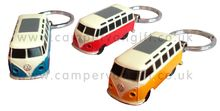 An Official VW campervan keyring with a built in torch. Press the button underneath to light up the VW Campervan headlights on this funky little torch.