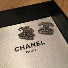 Authentic CHANEL Earrings - Classic C's Purchased at the San Francisco CHANEL location. When they were purchased one of the earrings back had come off but I never got to getting it put back on but it is included. One rhinestone is missing - second in from the left at the top. Box, ribbon and tags are included with your purchase. CHANEL Jewelry Earrings