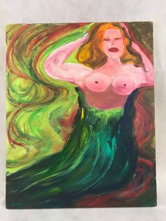 """Stunning Topless Mermaid, Oil Painting on canvas, created by a local artist here in NC. The Artist used his painting as therapy to cope with his PTSD from his tour of duty in Vietnam. I'm sure you will find his subject matter bold and his colors vibrant, giving it a """"Modern"""" look that will fit great in your den or Man-Cave! Measures approximately 18"""" tall by 14"""" wide. Combined shipping available on all orders. Please view pictures for details. 