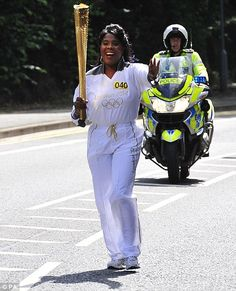 Tessa Sanderson carrying the Olympic Flame through Newham