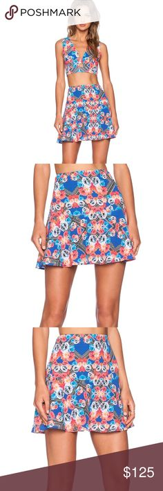 """X Naven Twins Floral Prism Skirt NBD features dresses that every girl covets with pieces that are sexy, flirty, fun and now. NBD is also one of the featured designers for many of the X Naven Twins fashions. This is such a fun and flirty skirt!   Poly blend Skirt measures approx 16"""" in length Fully lined Exposed back zipper closure NBD Skirts Mini"""