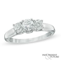 This ring showcases a trio of certified diamond center stones.
