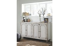With its distressed vintage paint finish, fluted details and French provincial mouldings, the exquisite Mirimyn cabinet is sure to grace your space in such a très chic way. Adjustable shelved storage is abundantly practical, be it in a dining room, bedroom or entryway.