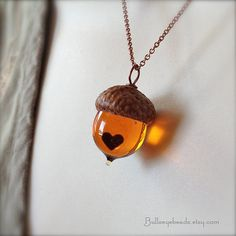"""an acorn necklace for Olivia...here are some quote ideas:   """"Faith sees a beautiful blossom in a bulb, a lovely garden in a seed, and a giant oak in an acorn."""" --william arthur ward  OR       """"From little acorns mighty oaks do grow"""" --american proverb"""