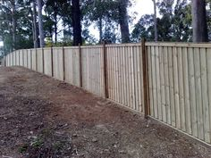 Paling timber fence with exposed hardwood posts. The palings are lapped, capped and has a fascia at the top. The fence is sitting on a sleeper base. Wooden Gates, Wooden Fence, Good Neighbor Fence, Fence Builders, Timber Fencing, Types Of Fences, Outdoor Bathrooms, Front Fence, Backyard Projects