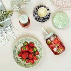 Strawberries on a plate and a bottle filled with homemade lemonade – this is the…