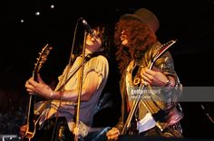 Guitarists Izzy Stradlin and Slash of the rock group 'Guns n' Roses' perform onstage at The Arlington Theater on October 23,1986 in Santa Barbara, California. The band was opening for Alice Cooper but their singer Axl Rose was late and the security wouldn't let him in so the band went on without him and sang the Izzy and Slash sang the vocals.
