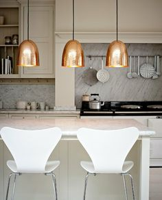 Copper Design Ideas Home Décor for Fall : Sleek Modern Design Lamp And White Chair For Kitchen Decoration With Copper Pendant Lamps And Marble Kitchen Islands Also White Modern Seats Also Marble Backsplash Ideas Interior Modern, Home Interior, Kitchen Interior, New Kitchen, Kitchen Decor, Interior Design, Gold Kitchen, Neutral Kitchen, Kitchen Pendants