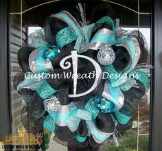 Black and Turquoise Christmas Wreath ( letter of choice ). $95.00, via Etsy.
