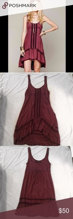 Free people burgundy slip dress Burgundy intimately Free People slip dress! Has stripes down the middle. Used, but in good condition. There's some minor piling in the armpit area, but that's the only flaw. It's shorter in the front and longer in the back. This dress is SOO soft!!   Material: 100% rayon Free People Dresses