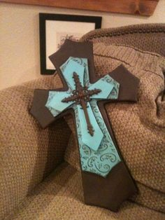 Large Turquoise and Brown Layered Wood Cross
