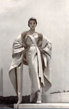 Jean Patchett wearing a blue and white satin evening gown by Christian Dior for Vogue, 1951. Photo by Toni Frissell.
