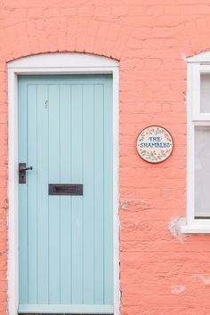 Cute pink and turquoise cottage in England UK