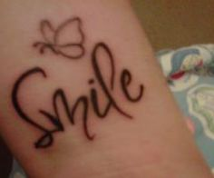 Google Image Result for http://www.tattooset.com/images/tattoo/2012/08/30/9064-smile-with-butterfly_thumb.jpg