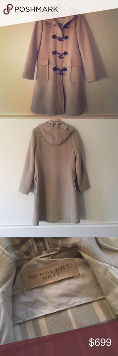 Host Pick  Burberry Brit wool coat with hood Beige outer with beige and grey tartan lining. Black buttons. Black metal clips and zipper. Slight discoloration on the bottom rear hem (barely visible in photo). Labeled size 6 but is old metrics - roughly equal to a 0. I'm usually a size S and this fits me Burberry Jackets & Coats Trench Coats