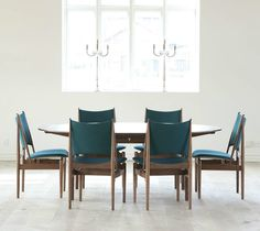 Finn Juhl designed FJ 136, as the chair was originally called, for France & Son for the American market in 1956. Along with a number of other Finn Juhl designs