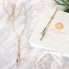 Tassel Mangalsutra, Modern mangalsutra, Everyday wear Mangalsutra, Tassel mangalsutra is our designer long chain mangalsutra. The long mangalsutra chain had a fixed gold knot. The piece is finished with two gold and diamond balls with a touch of black beads to preserve the cultural significance. A one-of-a-kind mangalsutra, Tassel is handmade from scratch by a team of four artisans. Made with finest quality solid gold and real diamonds. The diamonds are full cut, meaning they have 56-57…