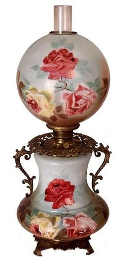 lighting, America, A large Gone With the Wind parlor lamp having hand-painted roses on its globe shade and concave reservoir, with brass handles and fittings. Circa (via Pin by Debbie Klinzing 2 on Antique Oil Lamps Other Lighting Antique Hurricane Lamps, Hurricane Oil Lamps, Antique Oil Lamps, Old Lamps, Vintage Lamps, Victorian Lighting, Victorian Lamps, Antique Lighting, Chandeliers