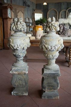 Pair of Vintage English Composite Stone Urns | From a unique collection of antique and modern urns at https://www.1stdibs.com/furniture/building-garden/urns/