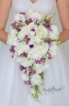white roses halo calla lilies Davids Bridal Wedding Flowers plum purple and lilacs cascading bouquet white roses