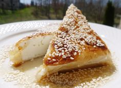 A super tasty and super easy cheese appetizer! An extraordinary combination of spicy feta, crispy phyllo and sour-sweet honey sauce, that will amaze you! This feta cheese appetizer is a … Feta Cheese Recipes, Cheese Appetizers, Cheese Snacks, Vol Au Vent, Profiteroles, Strudel, Pastry Recipes, Cooking Recipes, Uk Recipes