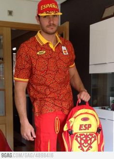 A pizza guy? No, its the Spains official Olympics uniform.
