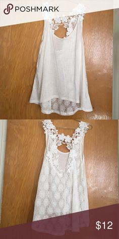 Charlotte Russe off white top High low off white top. Pretty lace see through back with flower design. NWOT. Charlotte Russe Tops Tank Tops